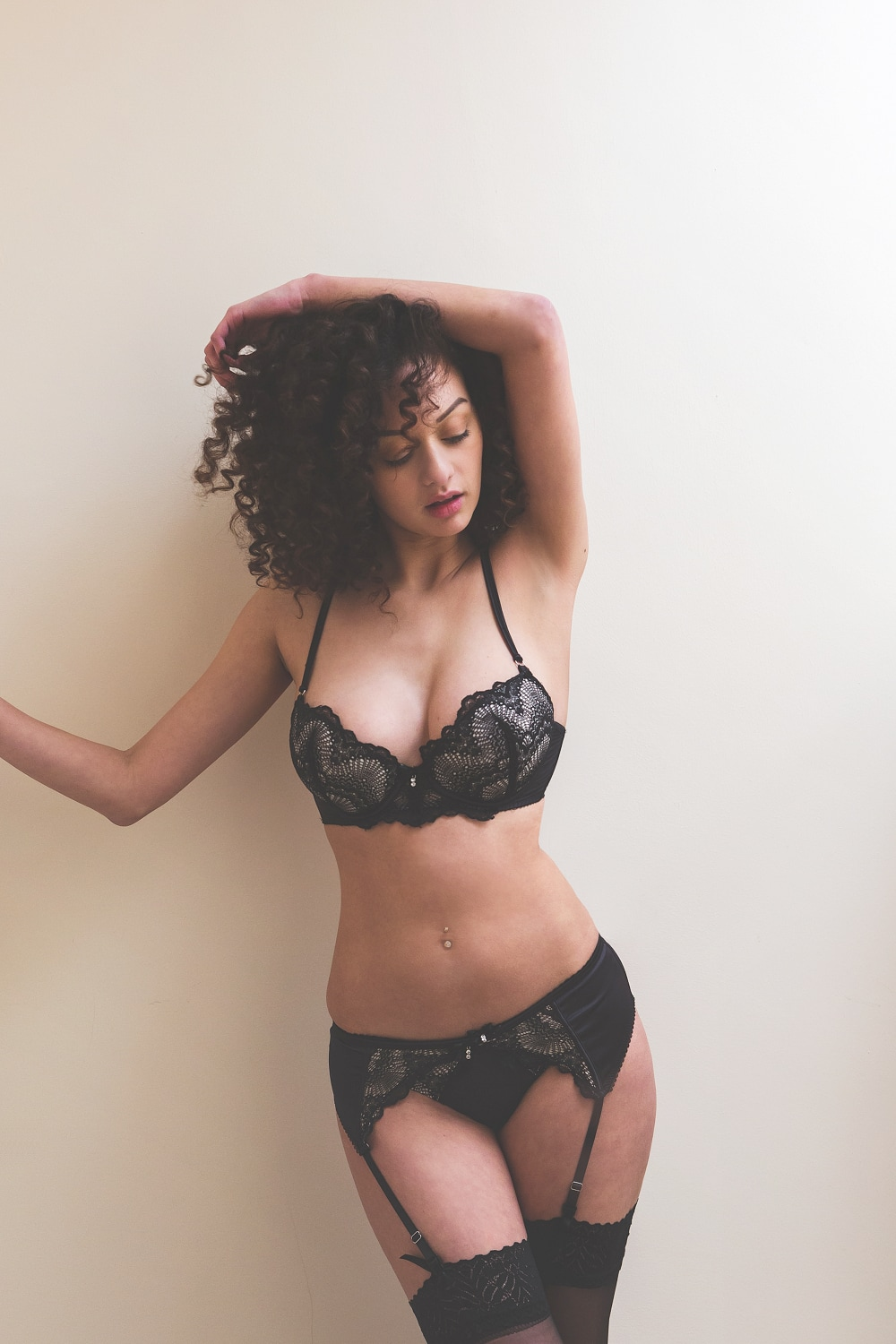 Photo of model in black lingerie