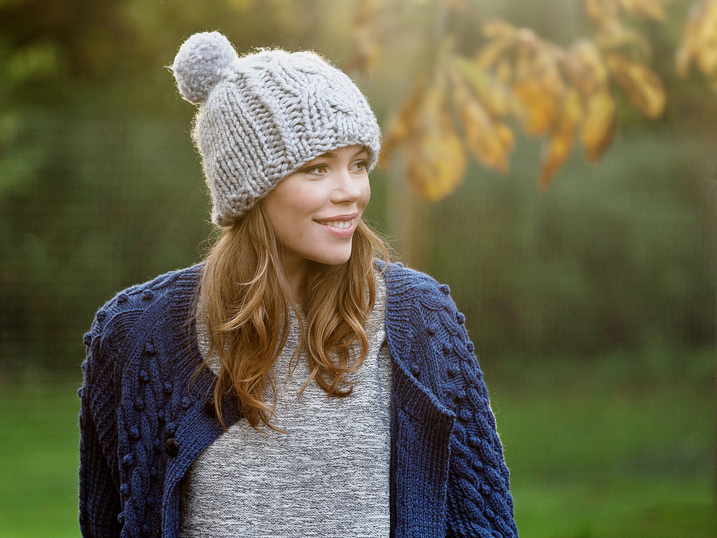 An autumnal photo of York singer, Rachel Croft, with a woolly hat and jumper.