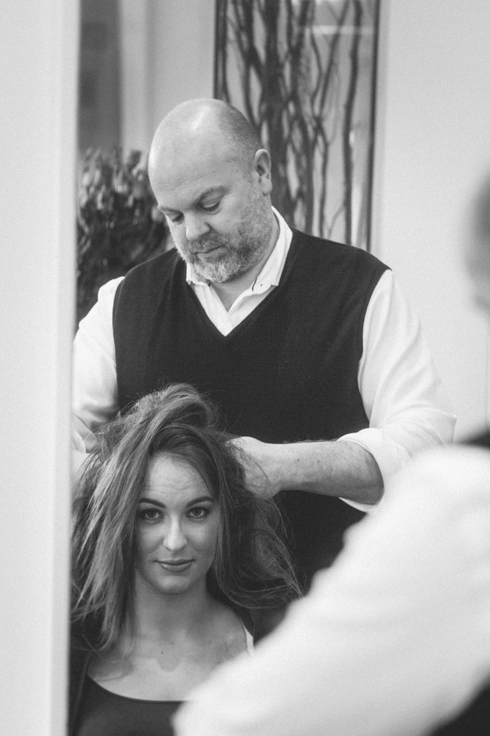 Wedding preperations, the bride getting her hair done.