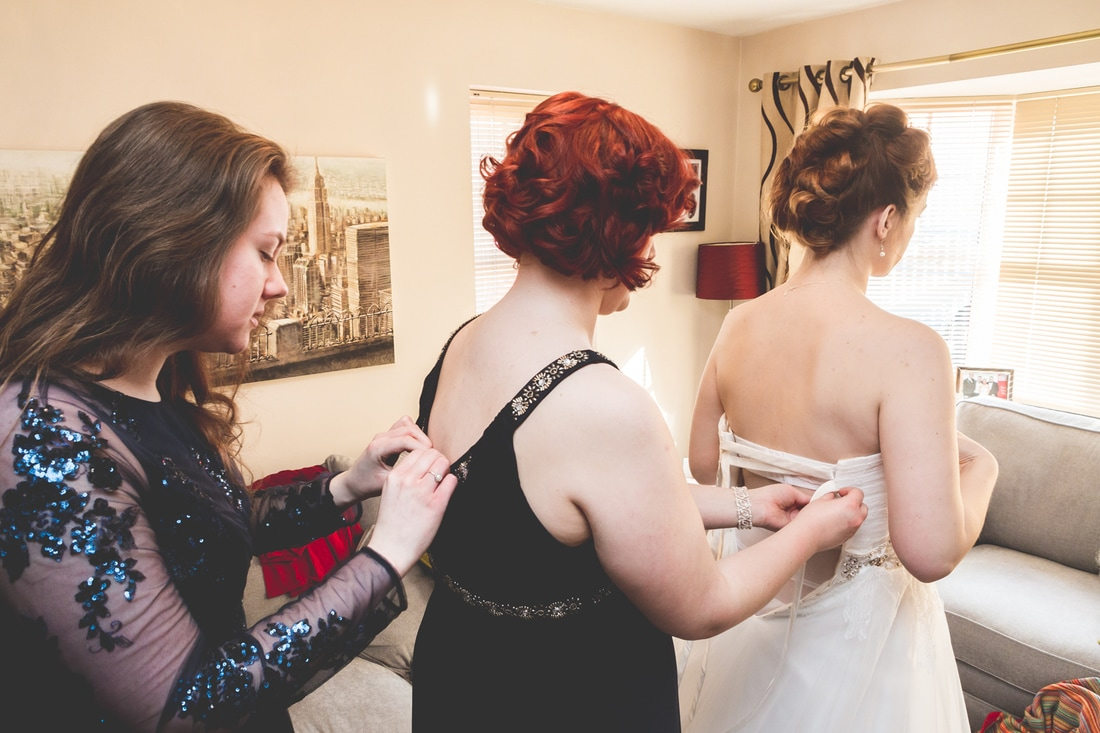 The bride getting ready with her bridesmaids.