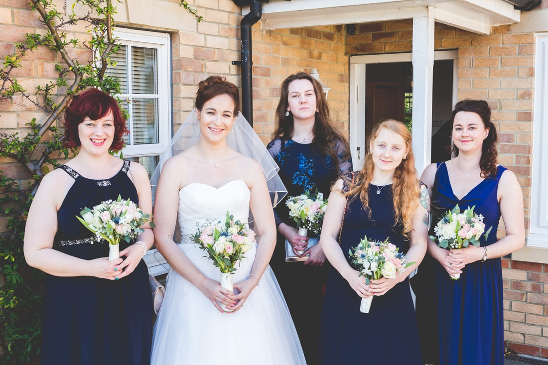 Wedding photo of the bride and bridesmaids.