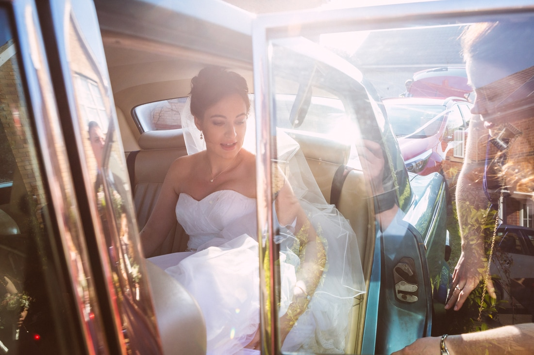 Beautiful image of the bride getting into her car, County Durham.