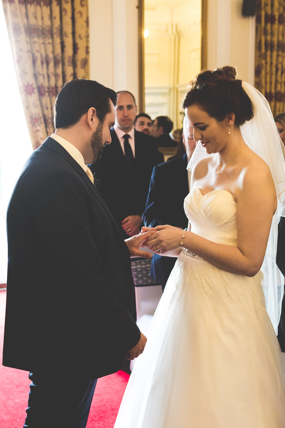 Exchanging the rings at walworth castle - Wedding photography by photographer Mat Robinson