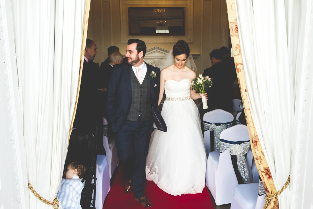 Just married - the bride and groom leave the ceremony  - Wedding photography by photographer Mat Robinson