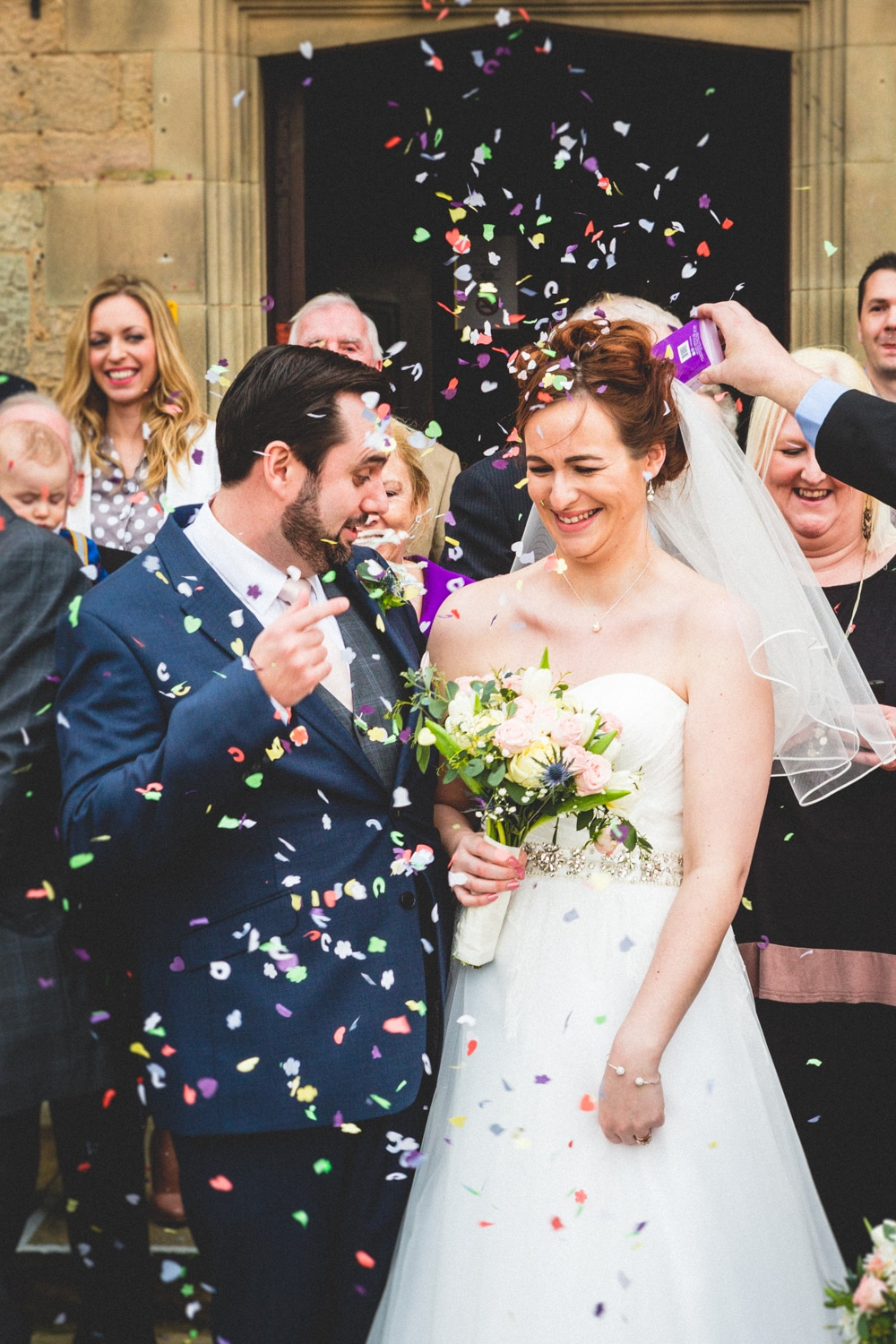 Confetti with the newly married couple - Wedding photography by Yorkshire photographer, Mat Robinson