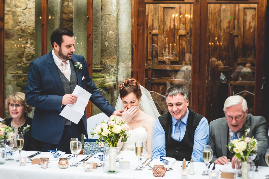 The groom's speech as the bride laughs- Wedding photography by Yorkshire photographer, Mat Robinson