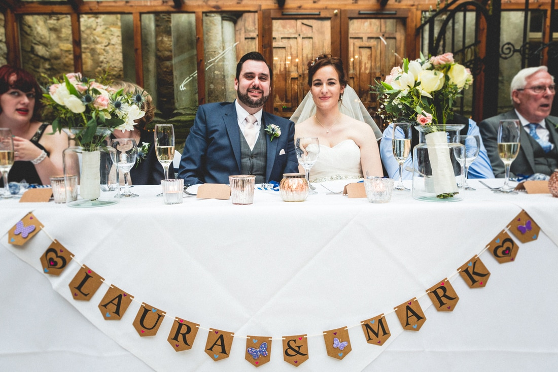 The happy couple at the top table at Walworth Castle. Wedding photography by Mat Robinson