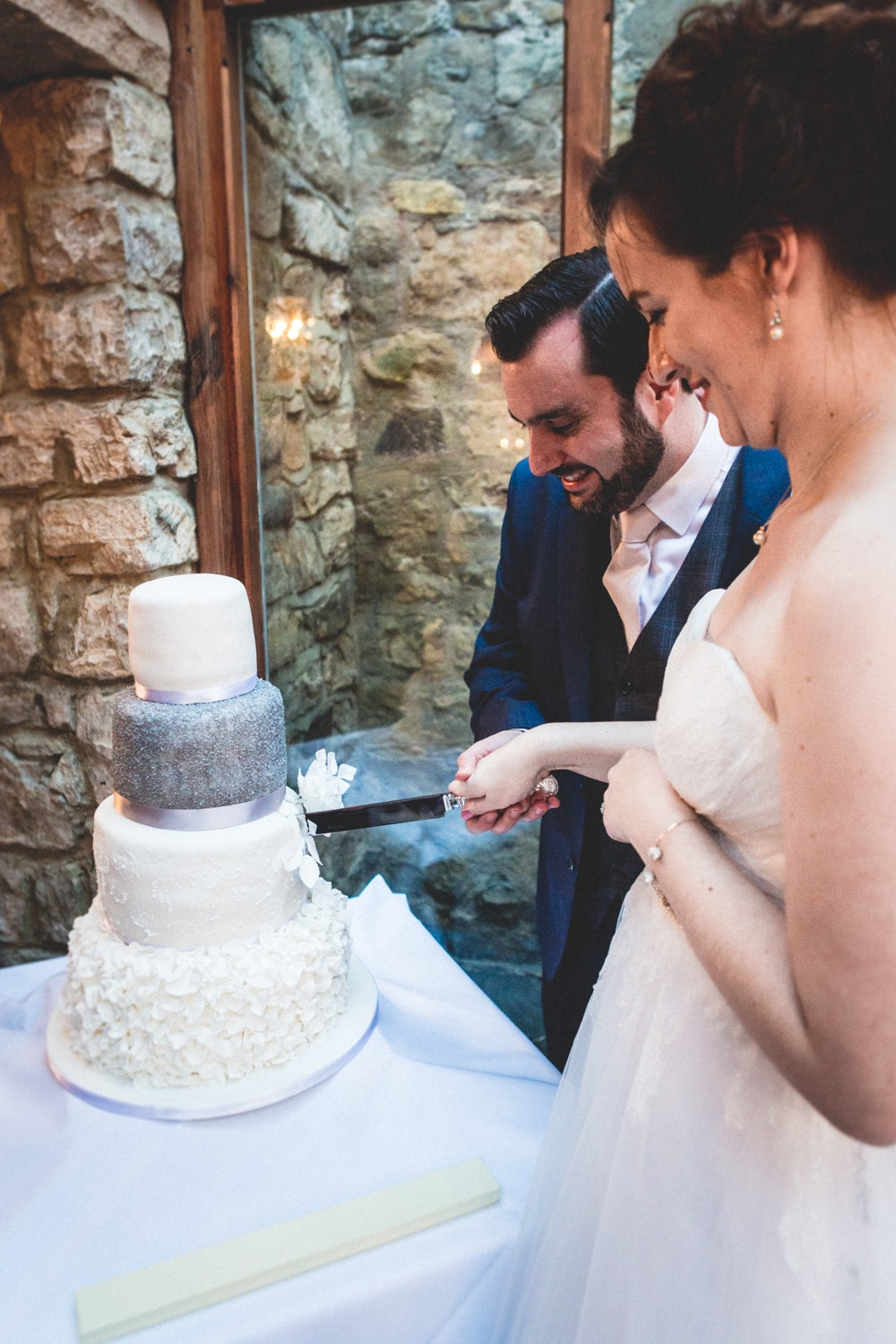 Cutting the cake - Wedding photography by Yorkshire photographer, Mat Robinson