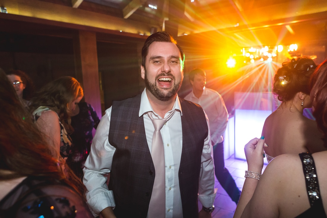 Picture of the groom enjoying the wedding party - Wedding photography by Yorkshire photographer, Mat Robinson