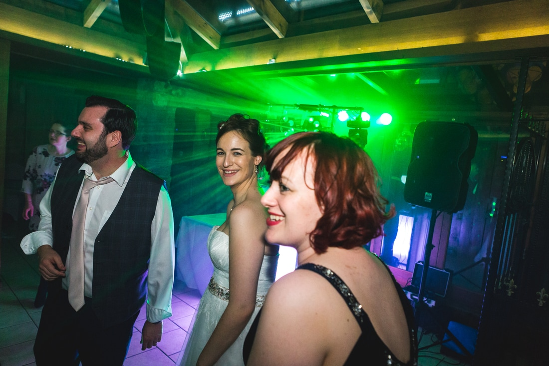 Picture of the bride smiling whilst dancing - Wedding photography by Yorkshire photographer, Mat Robinson
